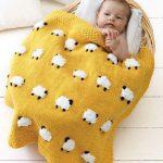 Tricot couverture bébé jacquard
