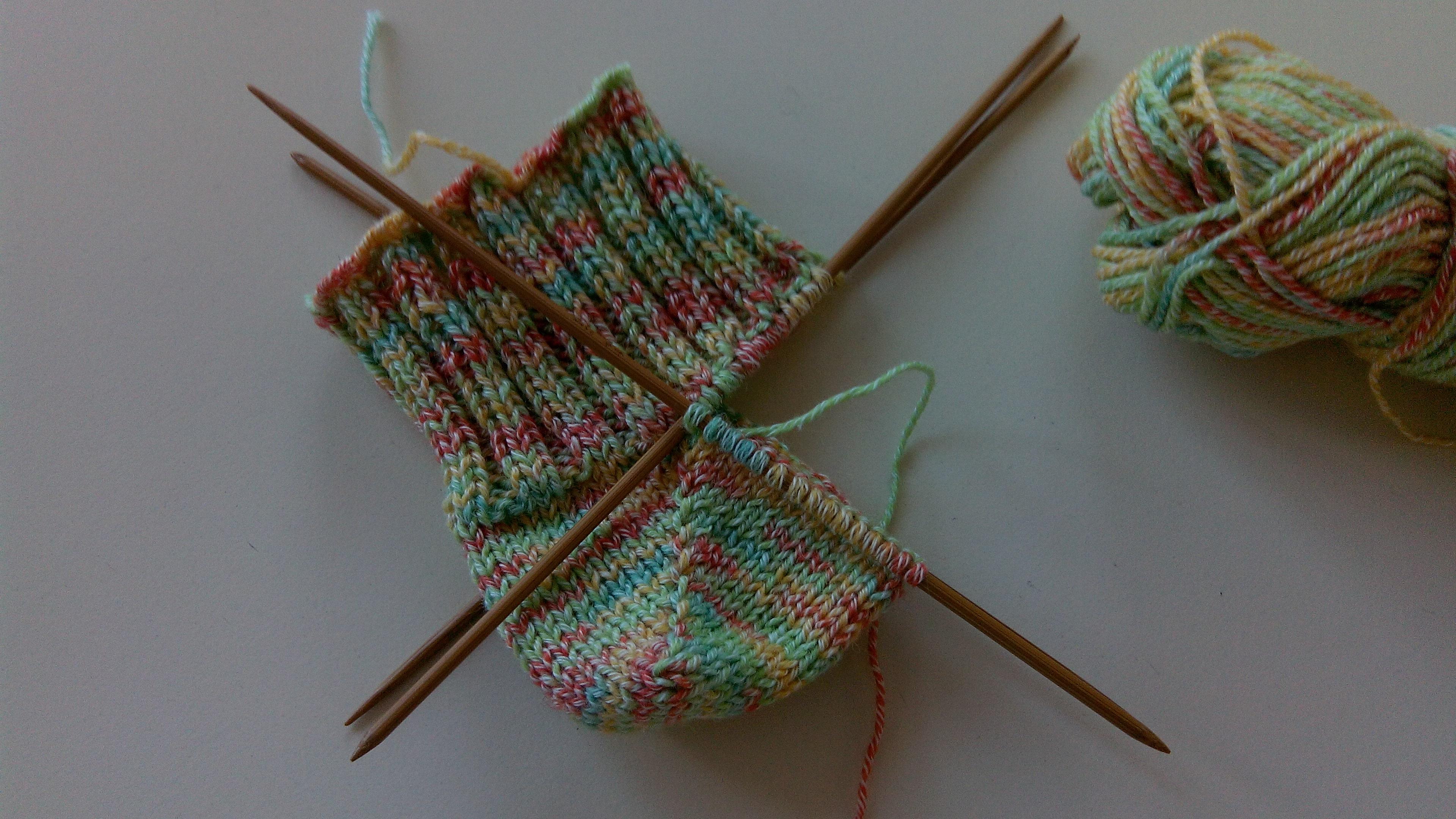 Tricoter quatre aiguilles