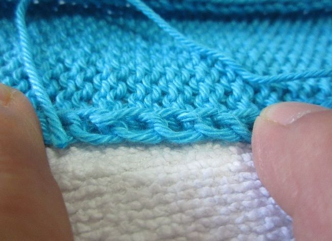 Tricot assemblage manche