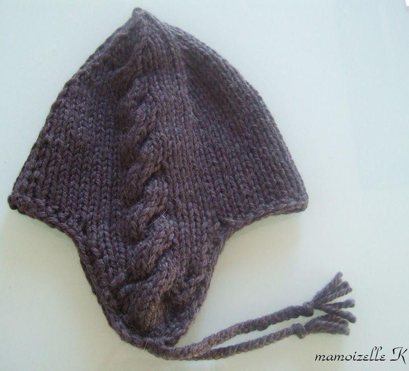 Tricot bonnet bébé avec cache oreille