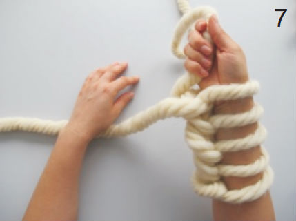 Tricoter avec les bras snood